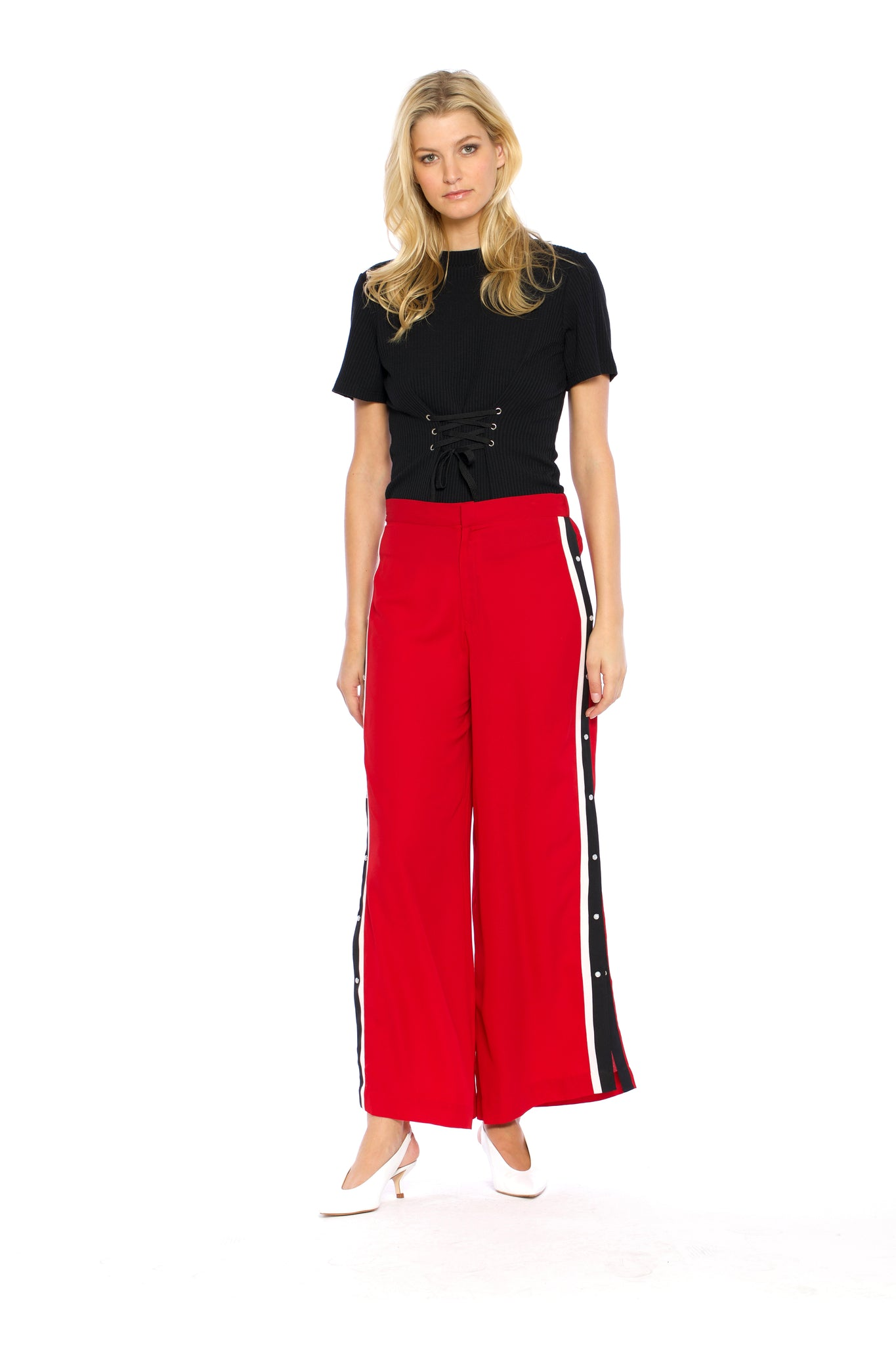 Front view of Maxine Pant, red retro pants with buttons on the side and a black stripe outlined with white borders on both sides, 100% Polyester and Machine-washable.