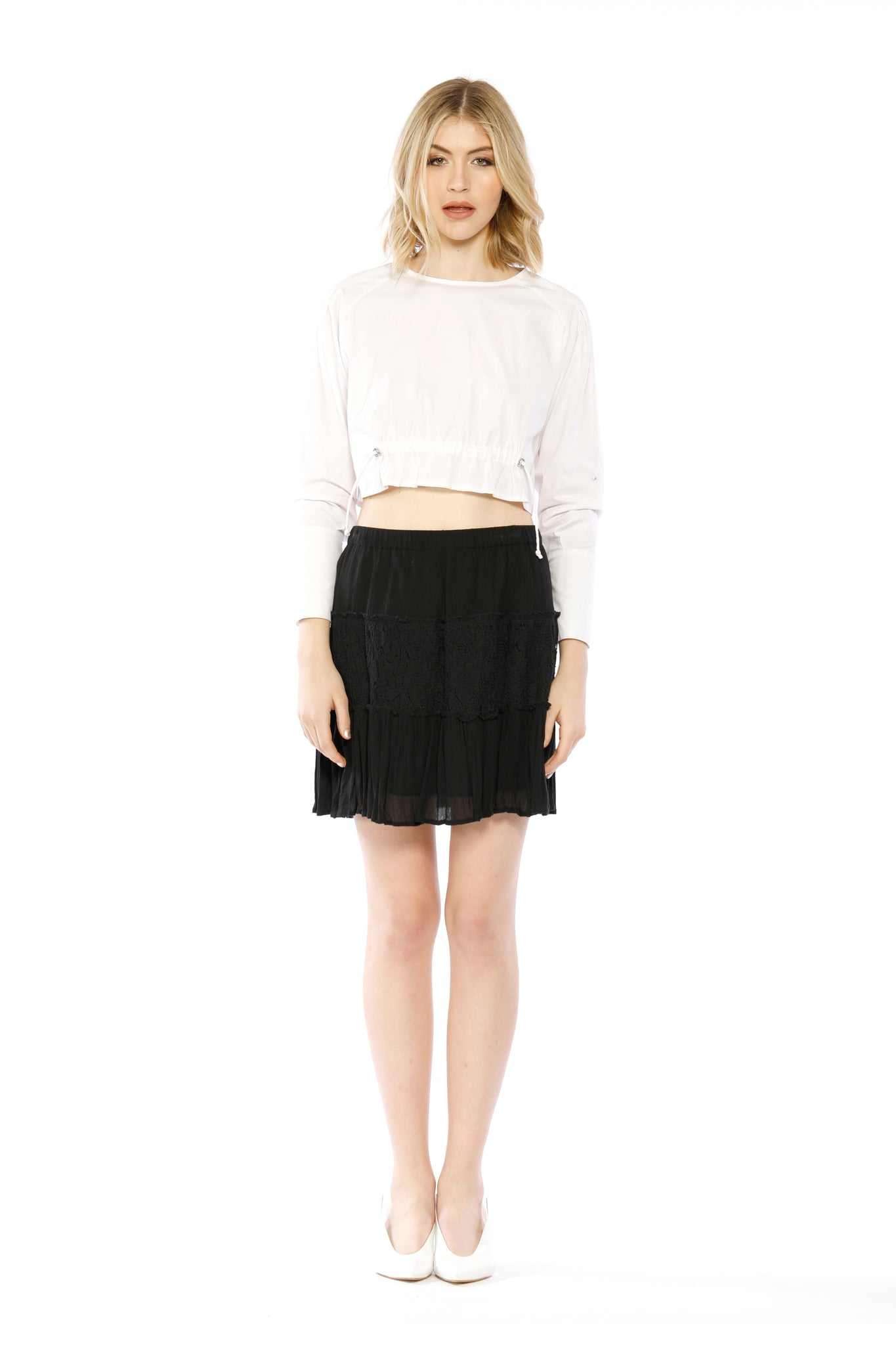 Front view of Fin Skirt, black skirt with layered frills and ruffles. 100% cotton and machine-washable