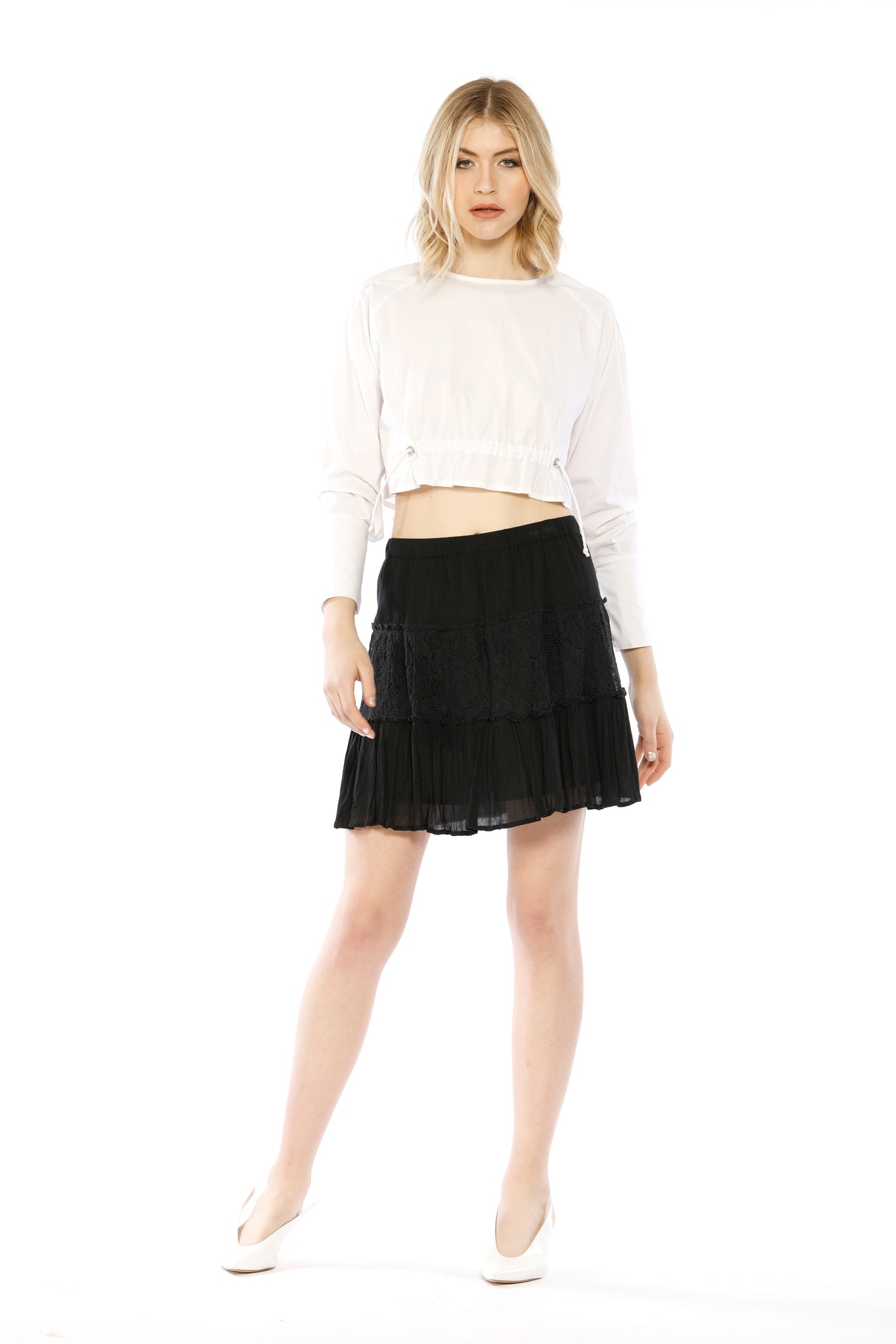 Front view (pose) of Fin Skirt, black skirt with layered frills and ruffles. 100% cotton and machine-washable