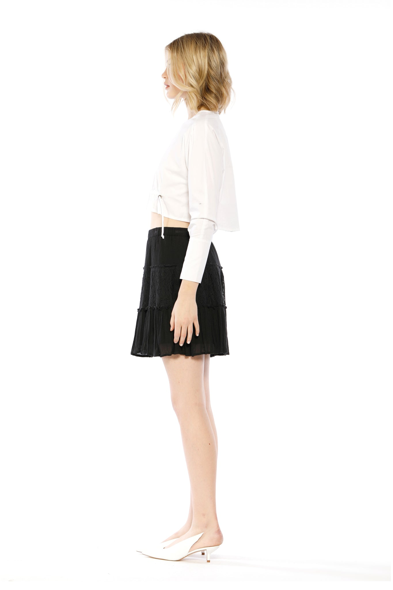 Side view of Fin Skirt, black skirt with layered frills and ruffles. 100% cotton and machine-washable