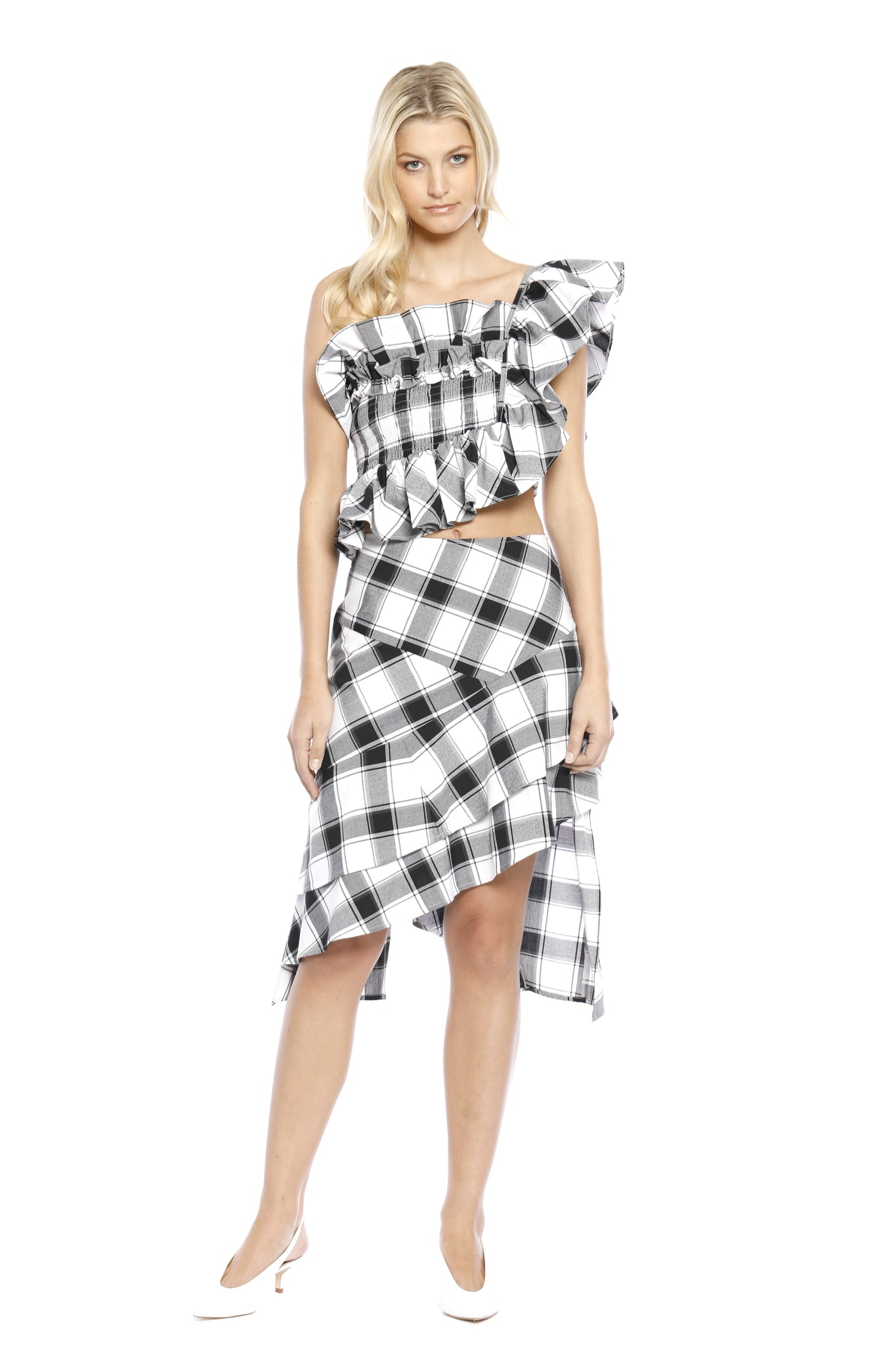 Front view of Ronda Skirt, asymmetrically layered black/white plaid skirt that is complementary to Margaret Top. 100% cotton and machine-washable.
