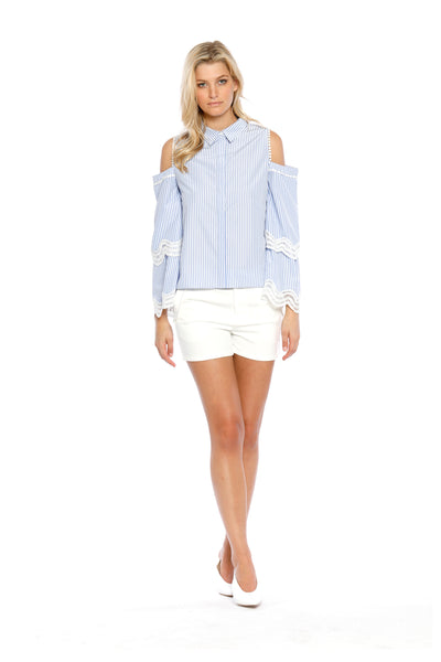 Front view of Darlene Top, long-sleeved, blue-striped Oxford Top with cold shoulder cutouts and white lace design at the elbows. 60% Supertone and 40% Cotton - and machine-washable.