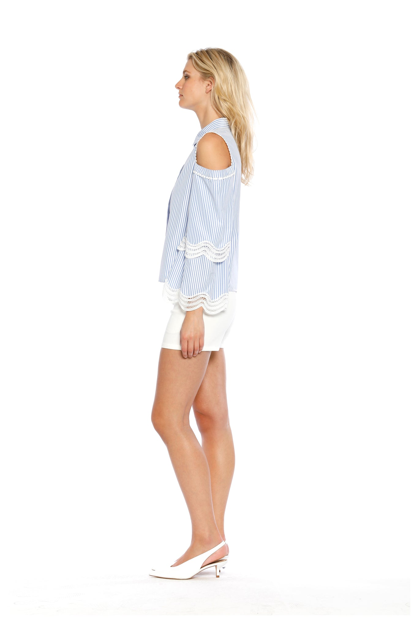 Side view of Darlene Top, long-sleeved, blue-striped Oxford Top with cold shoulder cutouts and white lace design at the elbows. 60% Supertone and 40% Cotton - and machine-washable.