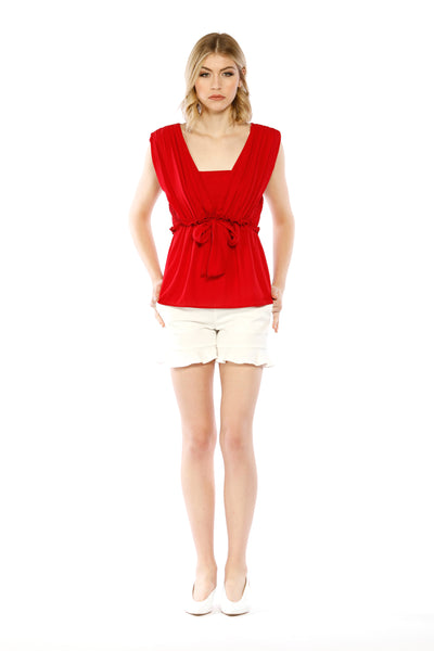 Front view of Claire Top, red top with wide neck cut and medium front waist tie. 100% Polyester and Machine-washable.