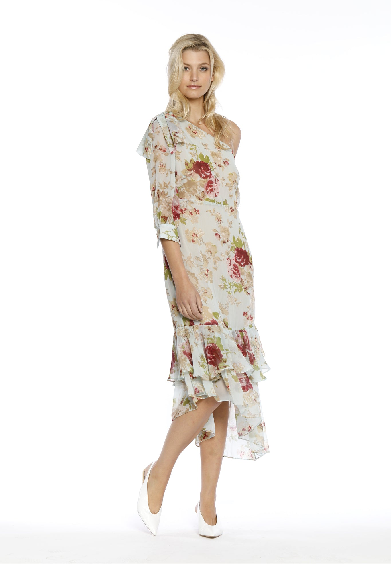 Front view (pose) of Sophina Dress, one-shouldered floral top with spring bloom motif and layered frills. Shell and lining are 100% polyester and machine-washable.