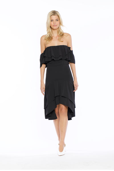 Front view of Patti Dress, black, open-shouldered high-low top with butterfly sleeves. 100% polyester and machine-washable.