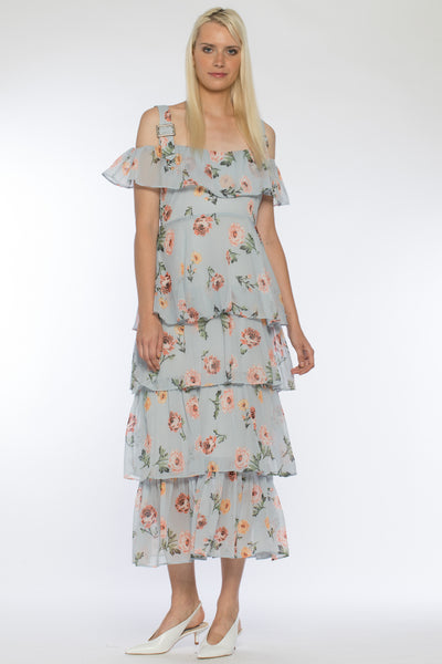 Front view of Coco Dress, long frilled open-shouldered spring dress with a light blue floral pattern. Shell and lining are 100% Polyester and Machine-washable.