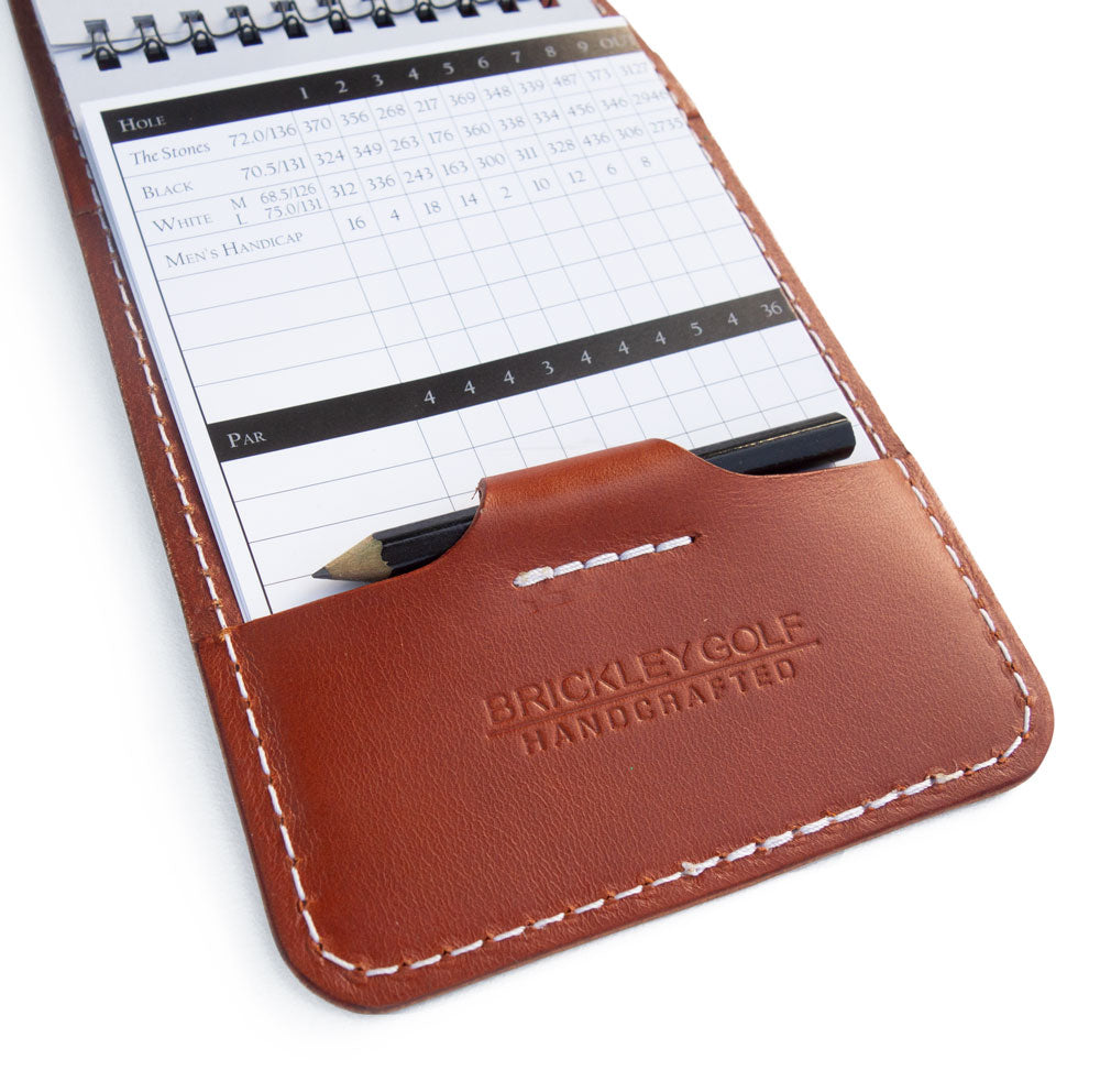 Chestnut leather yardage book cover with scorecard and pencil