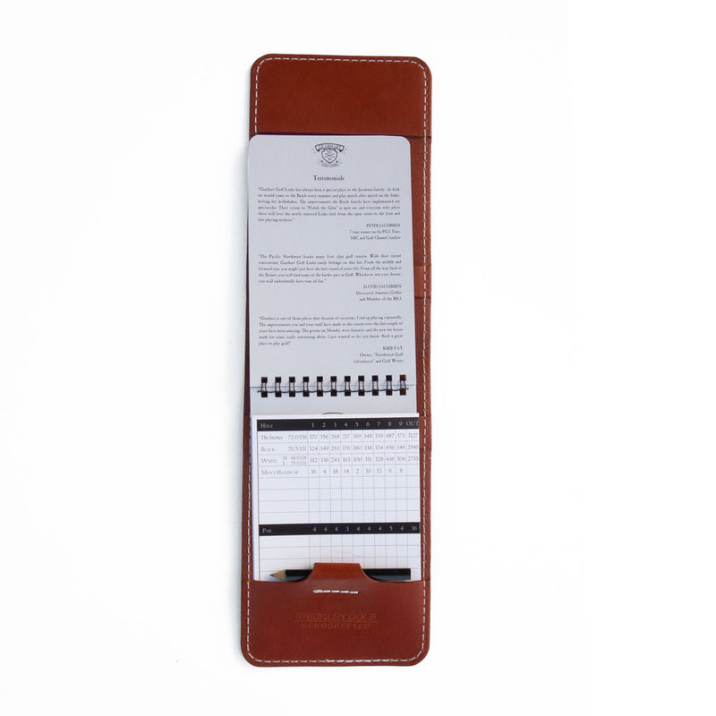 Chestnut leather yardage book cover with yardage book and pencil