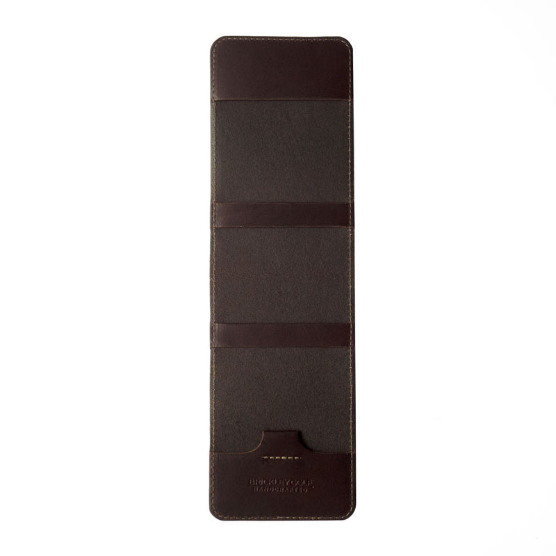 dark brown leather golf yardage book cover and scorecard holder open