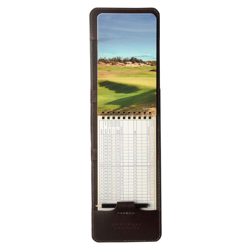 dark brown leather golf yardage book cover and scorecard holder with yardage book and pencil