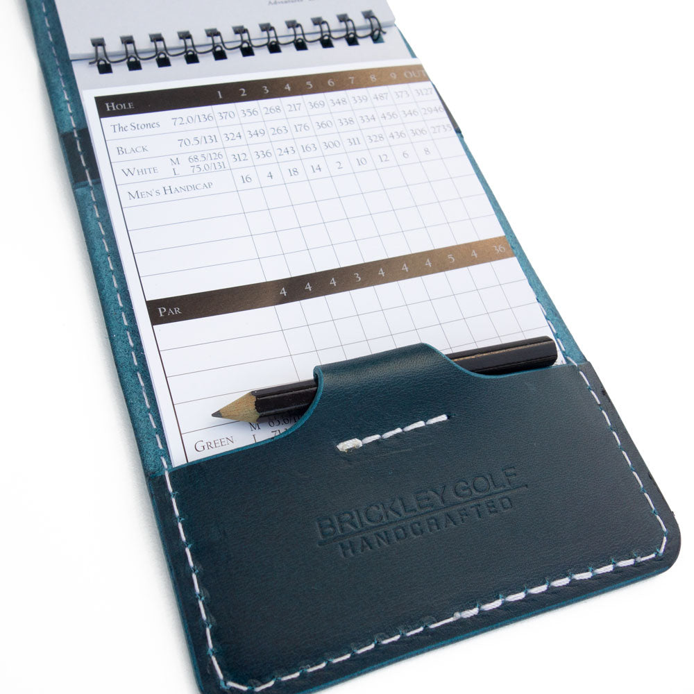 Pacific blue yardage book cover with scorecard and pencil