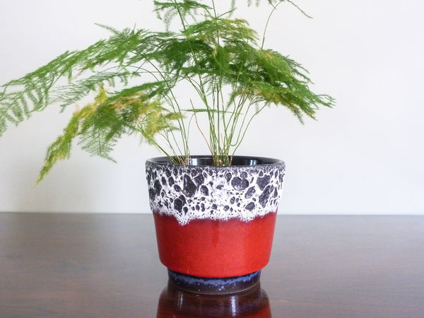 Vintage Jopeko indoor plant pot, red glaze with white and black lava