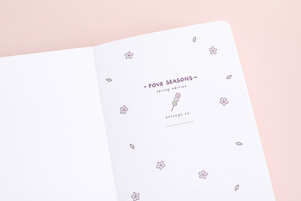 front cover spring notebook in pink background