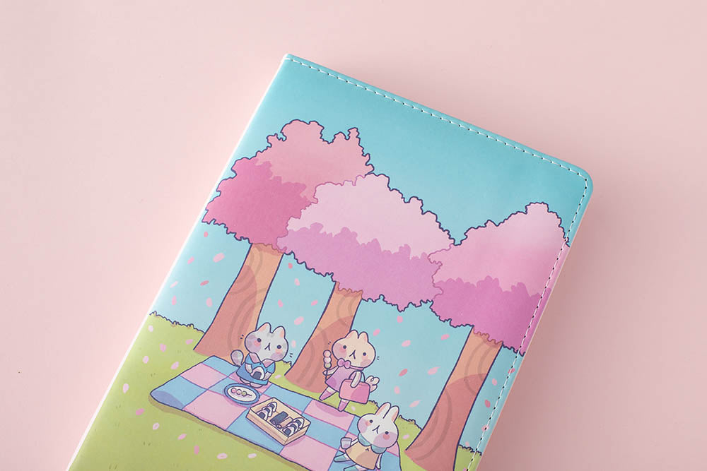 zoomed in front cover of the spring notebook in pink background