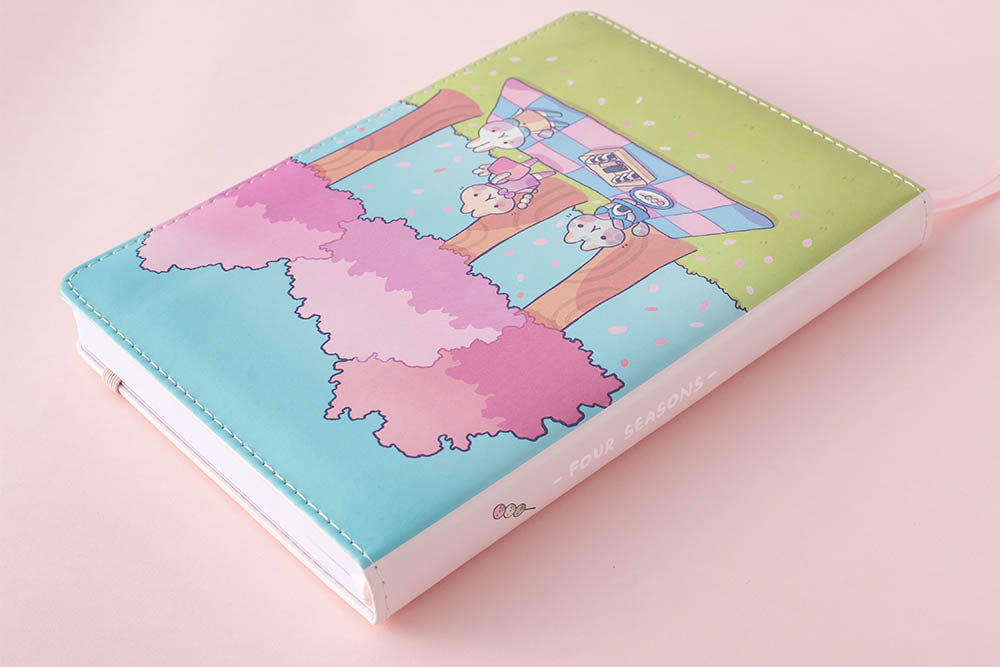 spring notebook spine in pink background