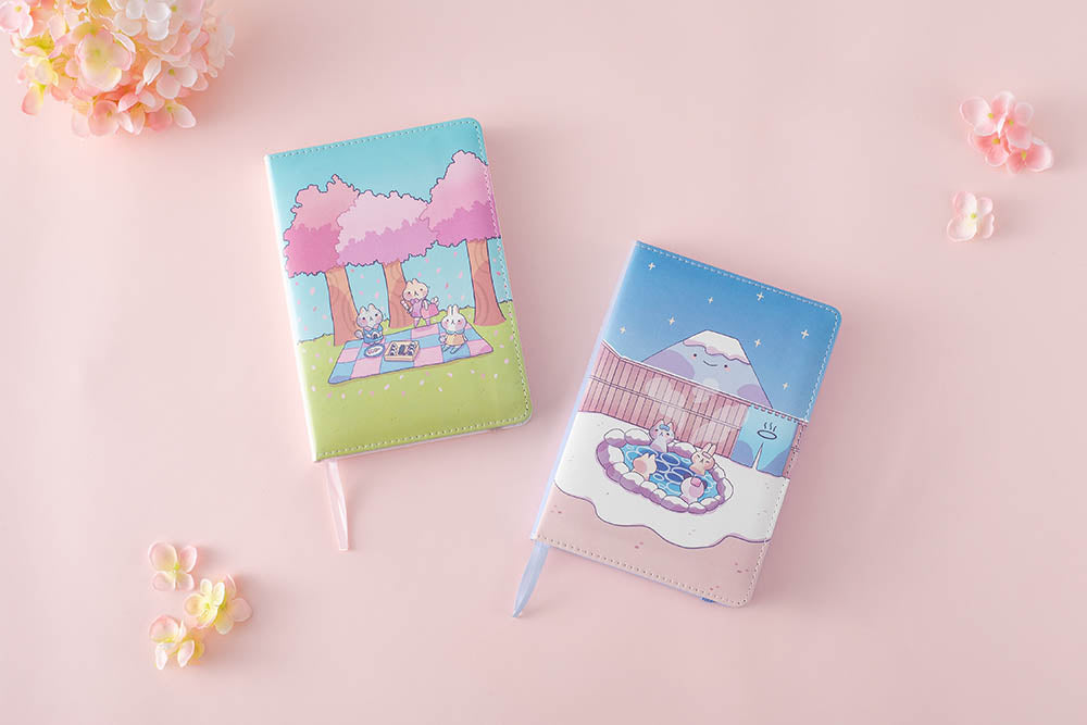 spring and winter edition notebook in pink background