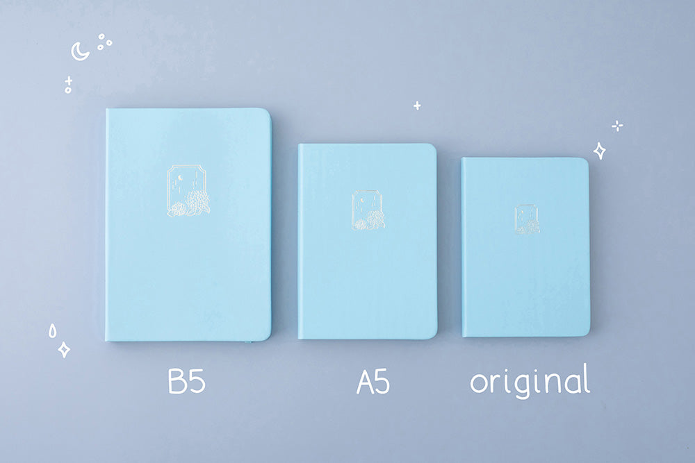 Tsuki Endless Summer Limited Edition Bullet Journal in Petal Blue in B5 and A5 and original sizes on light blue background