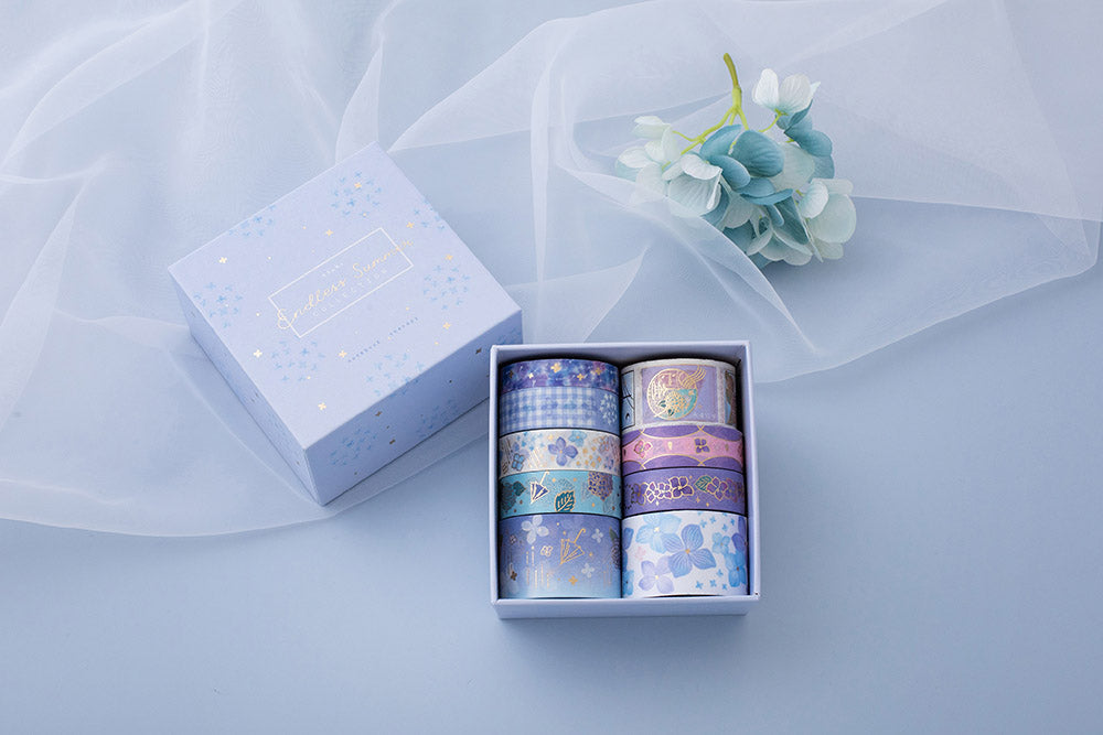 Tsuki Endless Summer washi tape set with eco friendly gift box packaging and free sticker sheets with blue hydrangea flowers with netting on light blue backgroun