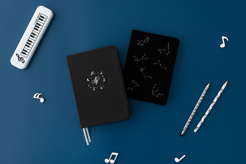 Tsuki Lunar Notes bullet journal with Black Tsuki Collestation bujo with music notes and stationary image on navy blue background