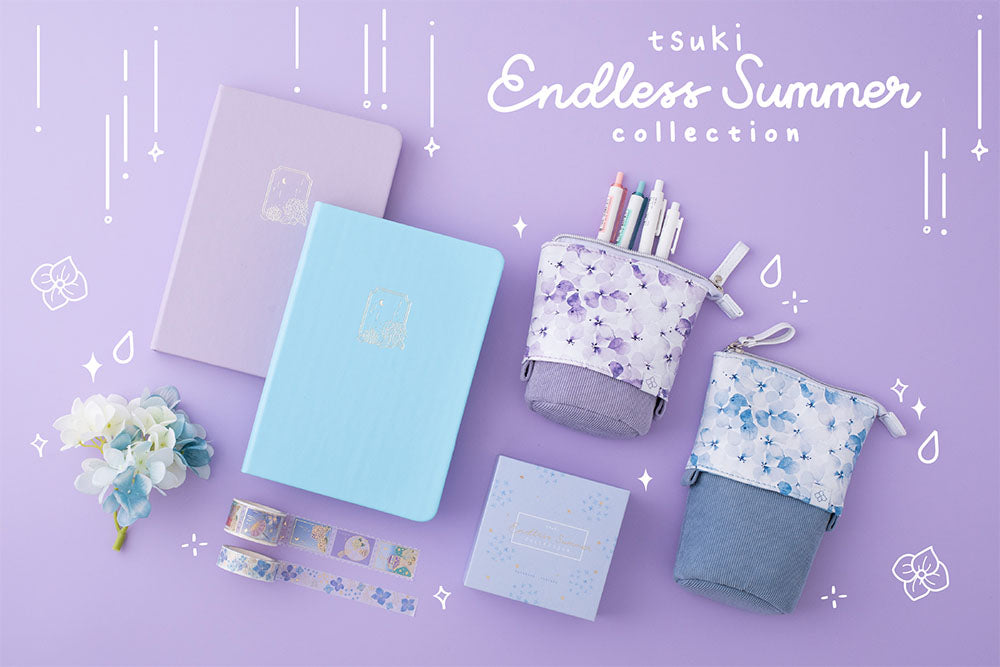Tsuki Endless Summer collection Washi Tape set with Tsuki Endless Summer Limited Edition Bullet Journals and Tsuki Endless Summer pop-up pencil cases with blue and white hydrangea flowers on lilac background