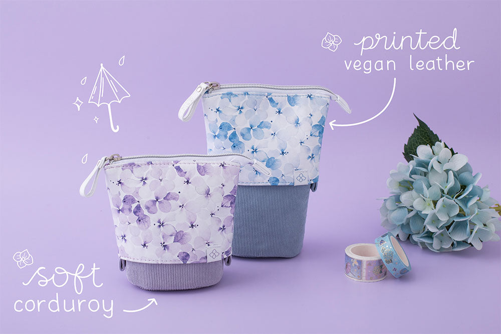 Tsuki Endless Summer Pop-Up Pencil cases in Lilac Bloom and Petal Blue with printed vegan leather and soft corduroy with Tsuki Endless Summer washi tapes and blue hydrangea flowers in lilac background