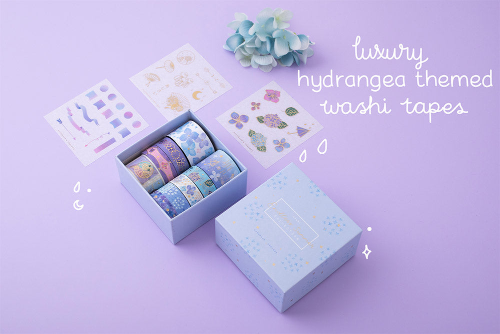 Tsuki Endless Summer luxury hydrangea themed washi tapes set with eco friendly gift box packaging and free sticker sheets with blue hydrangea flowers on lilac background