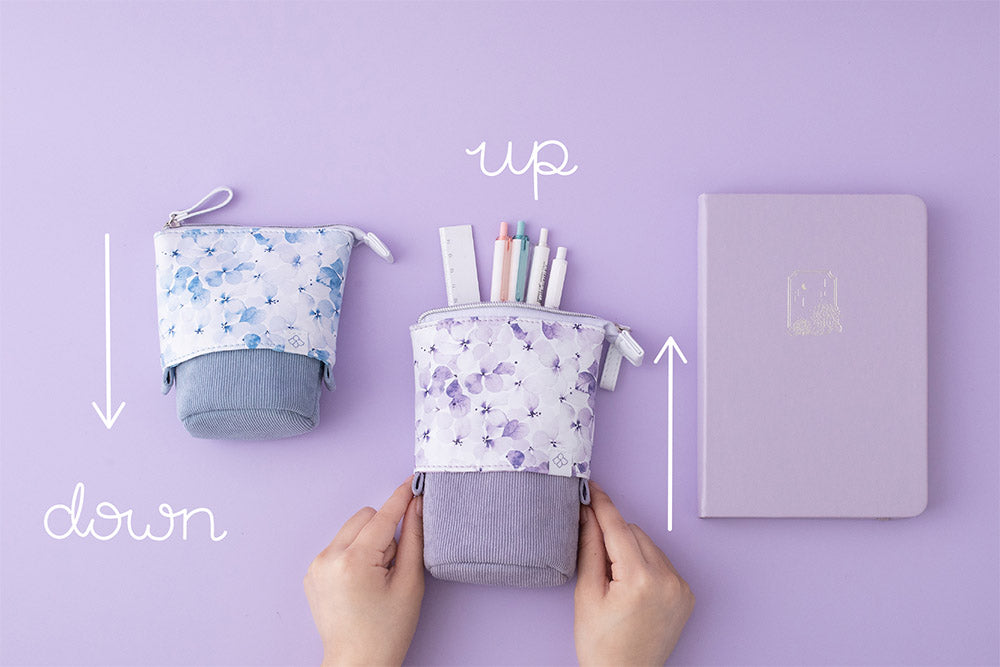 Tsuki Endless Summer Pop-Up Pencil cases in Lilac Bloom and Petal Blue with Tsuki Endless Summer Bullet Journal in lilac bloom on lilac background