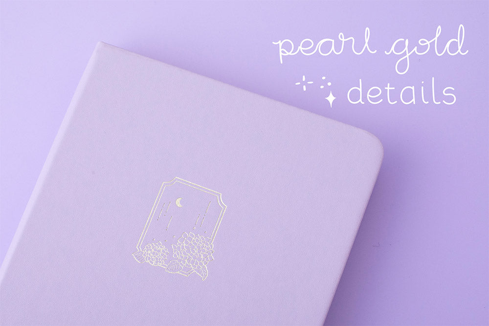 Close up of Tsuki Endless Summer Limited Edition Bullet Journal in Lilac Bloom with pearl gold details on lilac background