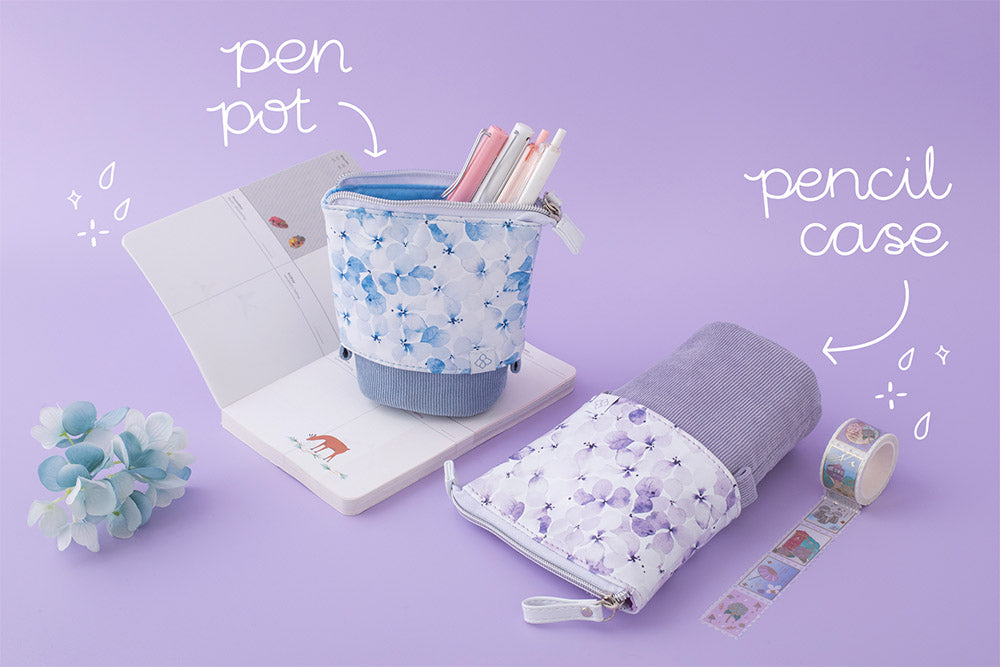 Tsuki Endless Summer pen pot and pencil case in lilac bloom and petal blue on open bullet journal page with blue hydrangea flowers and Tsuki Endless summer washi tape on lilac background