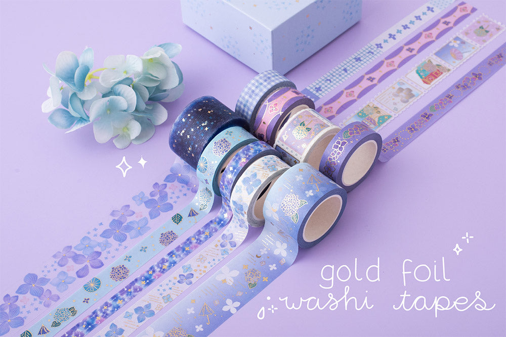 Tsuki Endless Summer gold foil washi tapes set with eco-friendly gift box packaging and blue hydrangea flowers on lilac backgroun