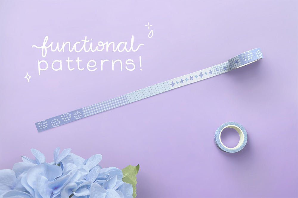Tsuki Endless Summer washi tape roll with functional patterns and blue hydrangea flowers on lilac background
