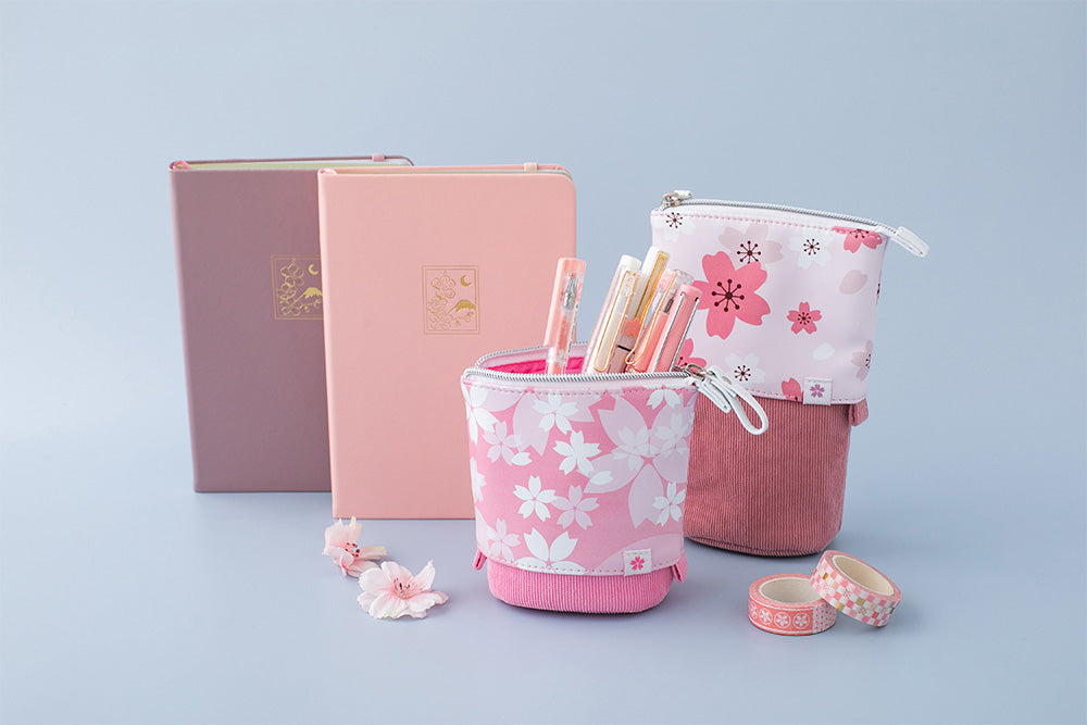 Sakura pop-up pencil cases, petal pink, and blush pink cherry blossom fuji-san themed bullet journal notebook in soft blue background