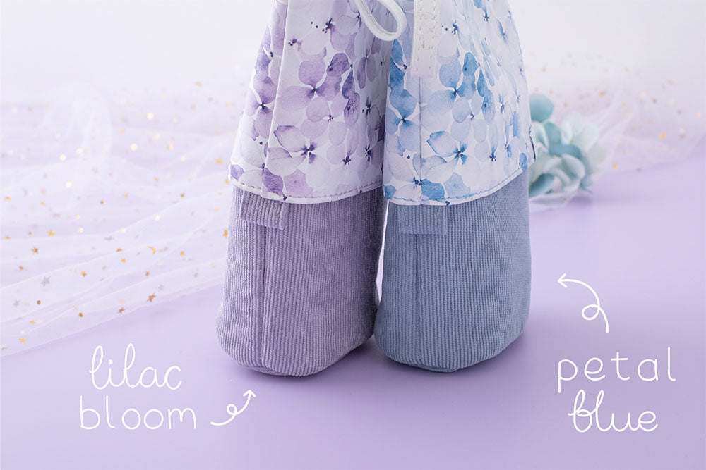 Tsuki Endless Summer Pop-Up Pencil cases in lilac bloom and petal blue with sparkly netting and blue hydrangea flowers in lilac background