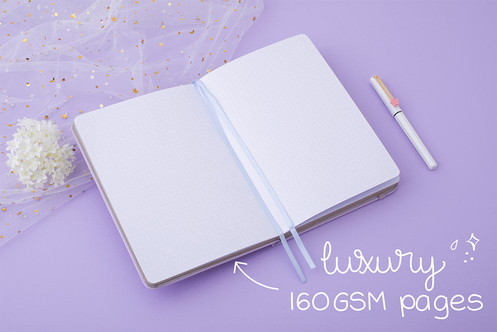 Tsuki Endless Summer Limited Edition Bullet Journal in Lilac Bloom with luxury 160GSM pages with sparkly netting and white hydrangea flowers and pen on lilac background