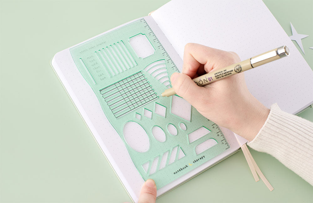 Draw with white bullet journal with mint green stencil