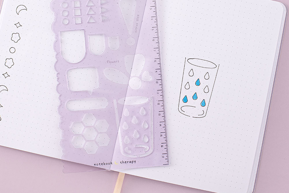 Create habit trackers with lilac purple stencil sheet on bullet journal
