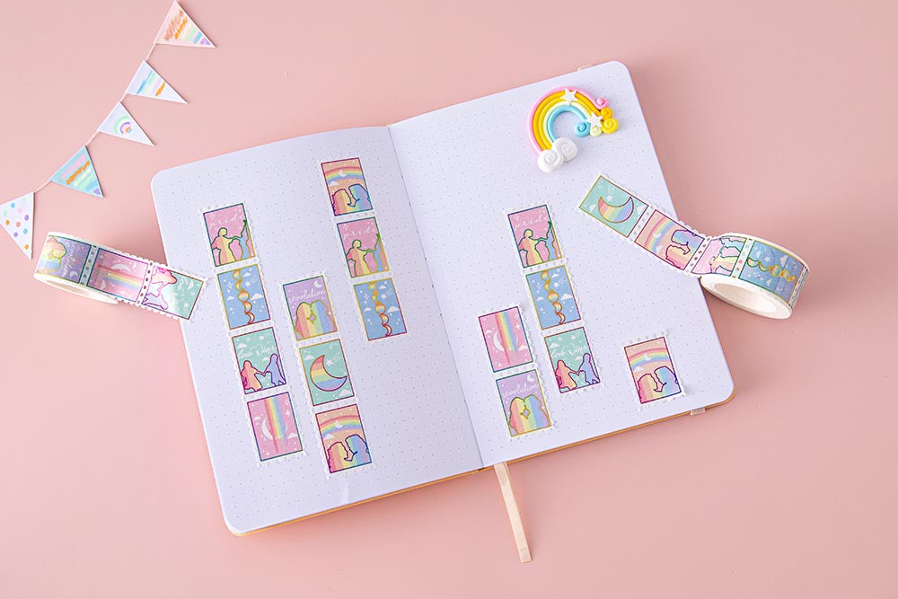 Tsuki Rainbow Pride Washi Tape on open Tsuki Pastel Edition Bullet Journal page with rainbow and bunting on light pink background