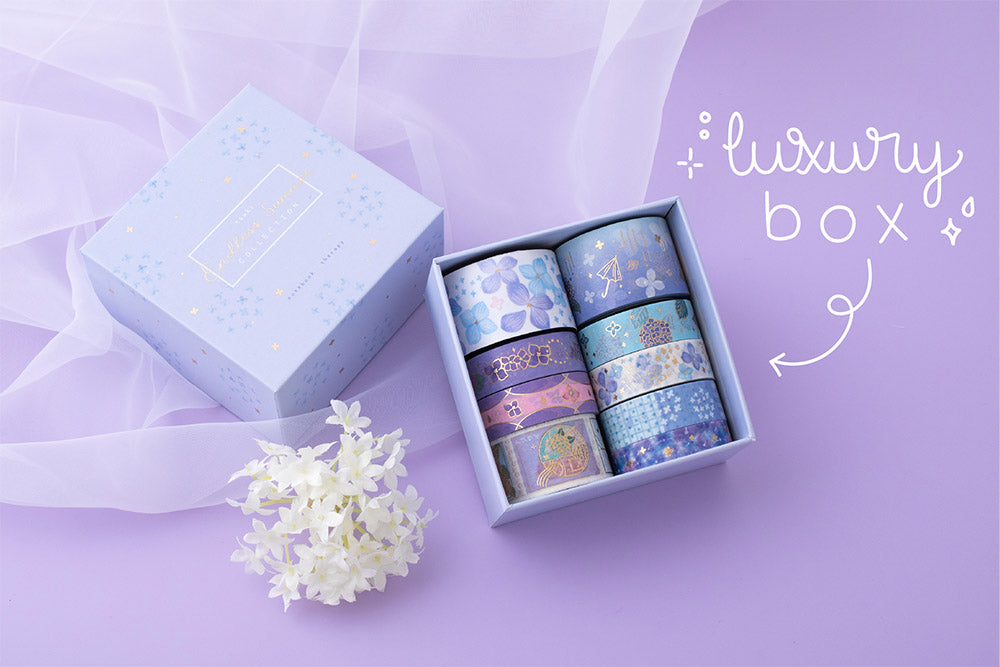 Tsuki Endless Summer washi tape set with luxury eco friendly gift box packaging and netting with white hydrangea flowers on lilac backgroun