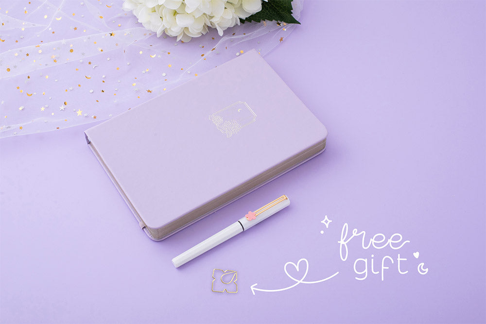 Tsuki Endless Summer Limited Edition Bullet Journal in Lilac Bloom with free gift with sparkly netting and white hydrangea flowers and pen on lilac background