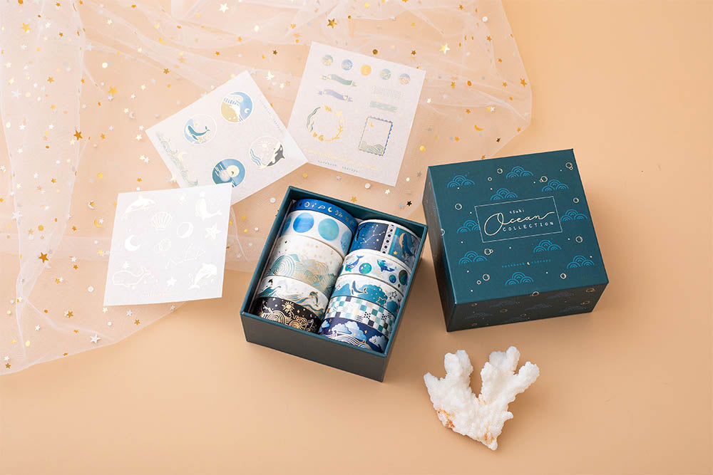Tsuki Ocean Edition Washi Tapes and sticker sheet set with reusable eco-friendly gift box and coral on peach background