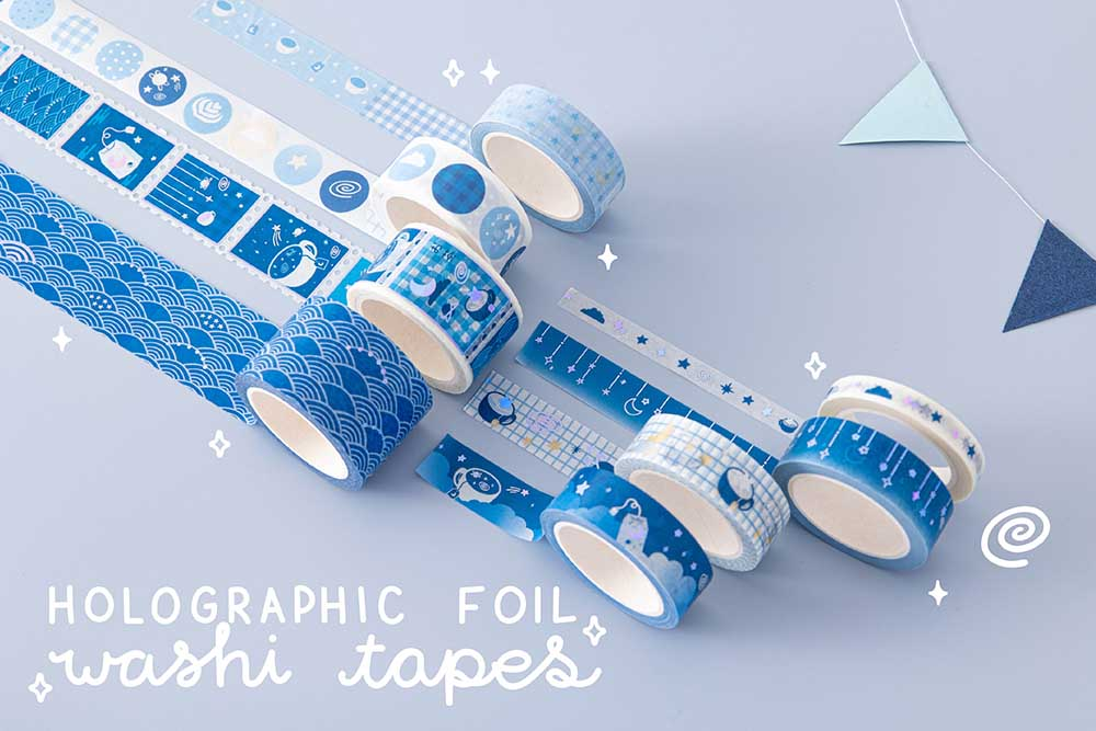Close up of Tsuki 'Cup of Galaxy' Washi Tapes held in hands in light blue background