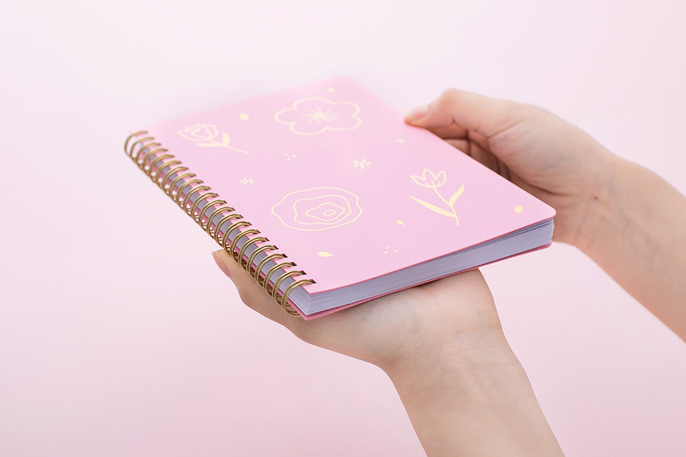 Tsuki Floral collection 3 ringbound bujos laid out on pink background