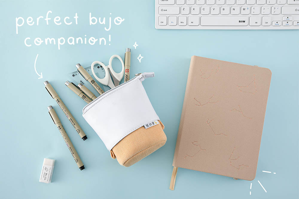 perfect bujo companion with yellow pop up pencil case and constellation star in blue background