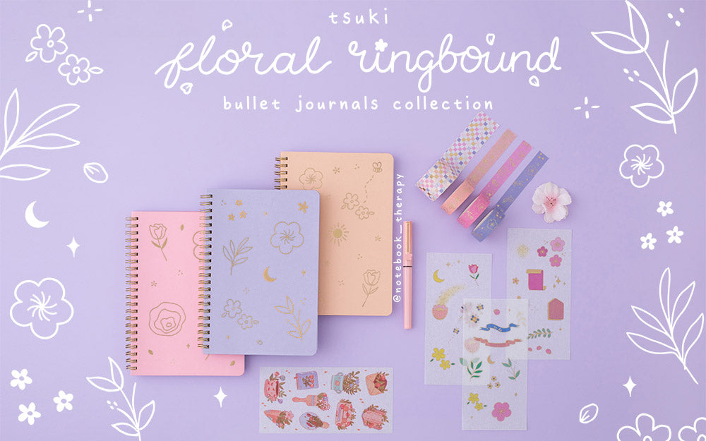 Tsuki Floral collection 3 ringbound bujo with washi tapes and sticker sheets laid out on lilac background with floral patterns