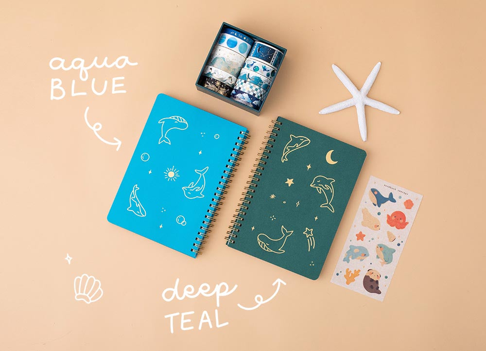 Tsuki Ocean Edition Ring Bound notebooks in aqua blue and deep teal with free sticker sheet and ocean edition washi tapes and sticker set with starfish on peach background