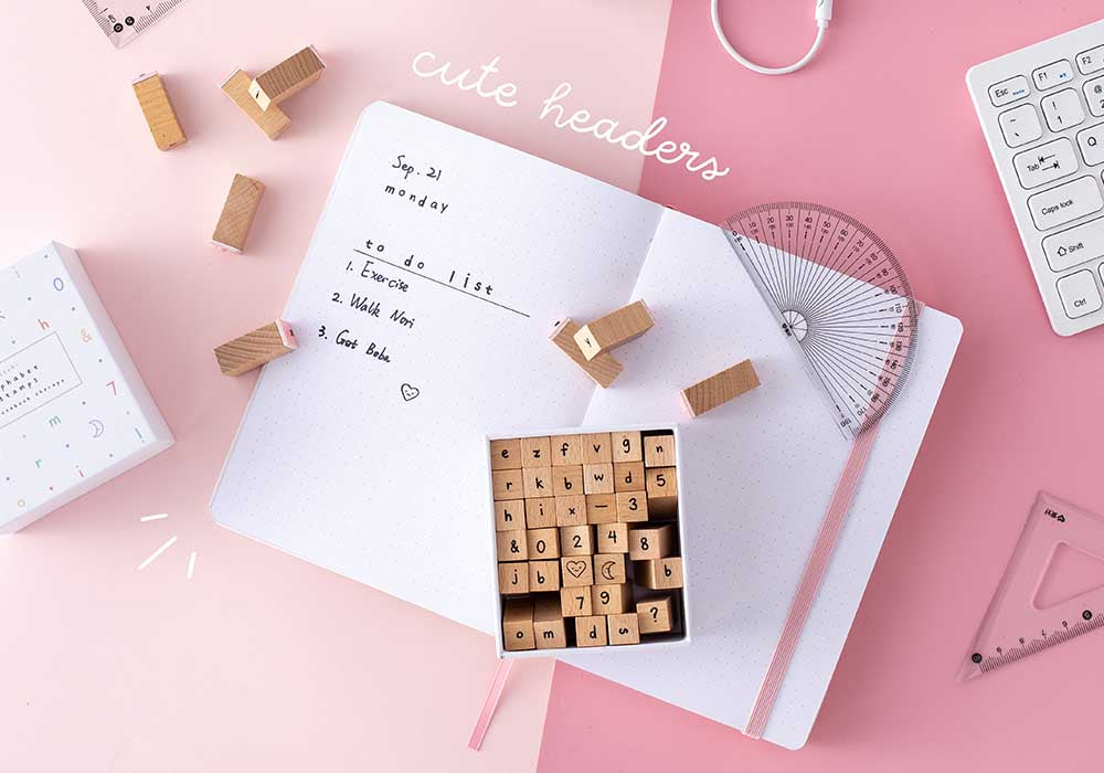 Alphabet stamps on a bullet journal to show that the stamps can be used to make cute headers