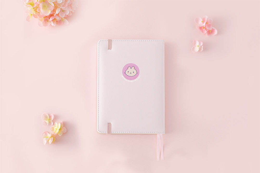 back cover spring notebook in pink background