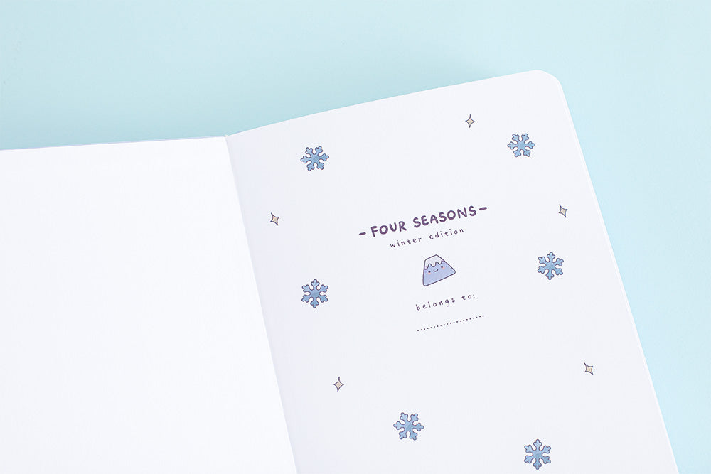 Cute aesthetic winter themed bullet journal cover page on a blue background