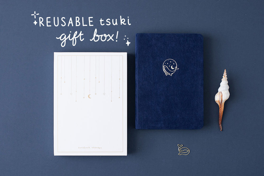 Tsuki deep blue Gentle Giant luxury edition notebook with eco-friendly reusable Tsuki gift box and seashell and free whale gift on dark blue background